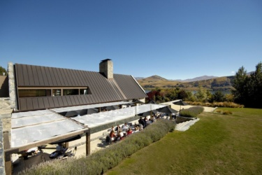 Amisfield Wine Company Lake Hayes Expansion, view of diners enjoying their meal alfresco on a sunny day.